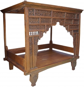 Old four-poster bed, day bed made of light teak wood